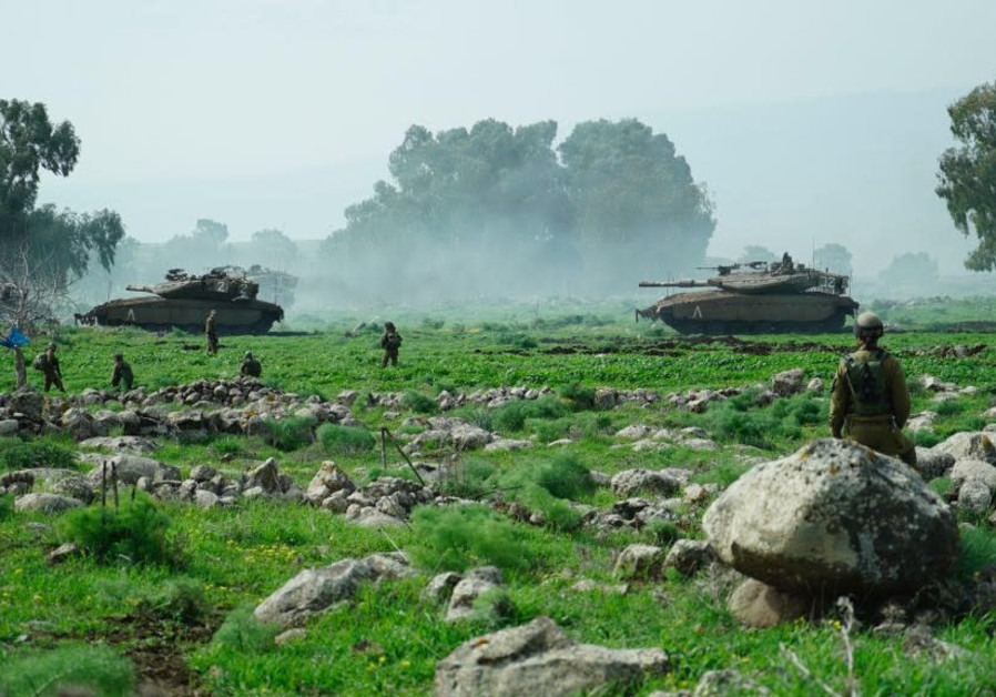 Israeli tanks manuever during an exercise near the northern border on February 22, 2018.