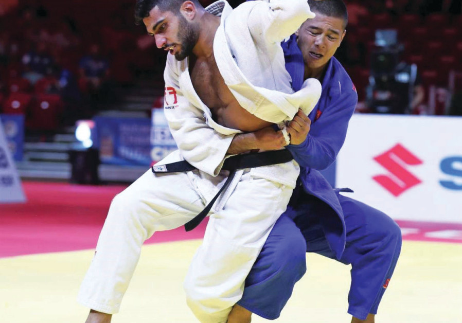 Israeli judoka wins bronze after Iranian pulls out of competition