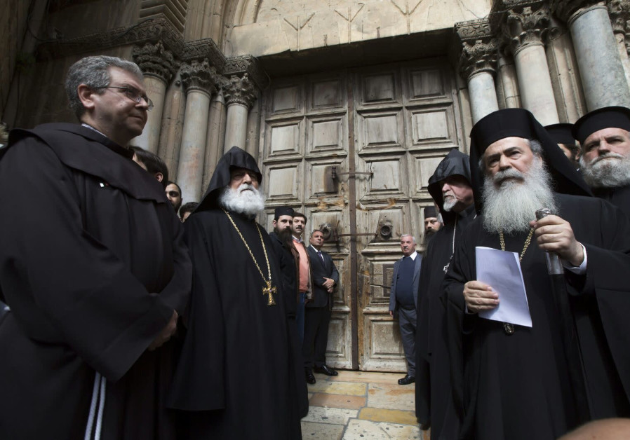 Jerusalem heads of churches in front of the Church of the Holy Sepulchre, which closed over municipa