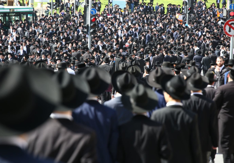 Haredi men gather in Jerusalem for the funeral of Rabbi Shmuel Auerbach