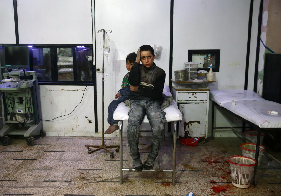Wounded children in a hospital in the besieged town of Douma, Eastern Ghouta, Damascus, Syria
