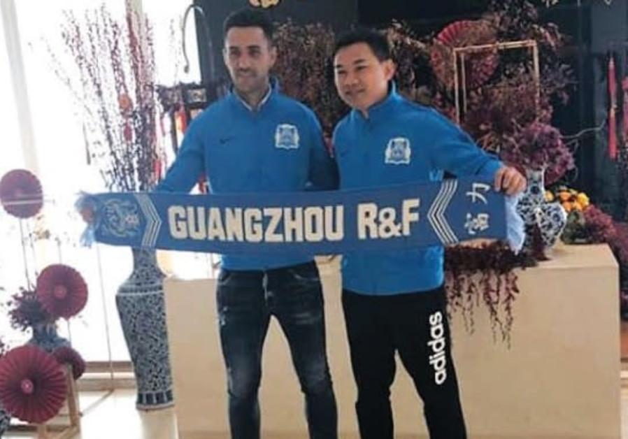 ISRAELI SOCCER STAR Eran Zahavi (left) poses with Guangzhou R&F chairman Zhang Li.