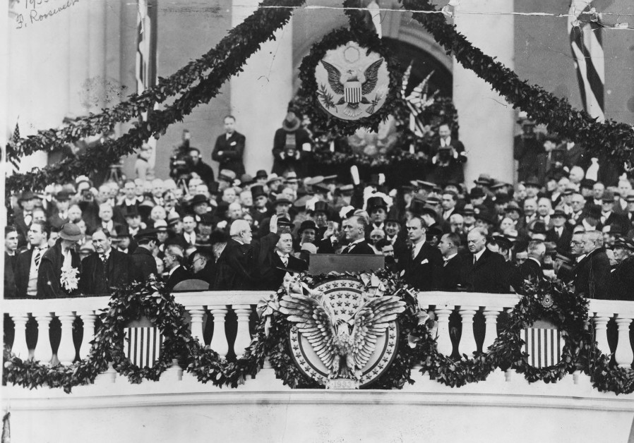 FRANKLIN DELANO Roosevelt takes the Oath of Office from chief justice Charles Evans Hughes.