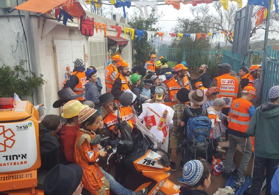 Kids dressing up as United Hatzalah volunteers