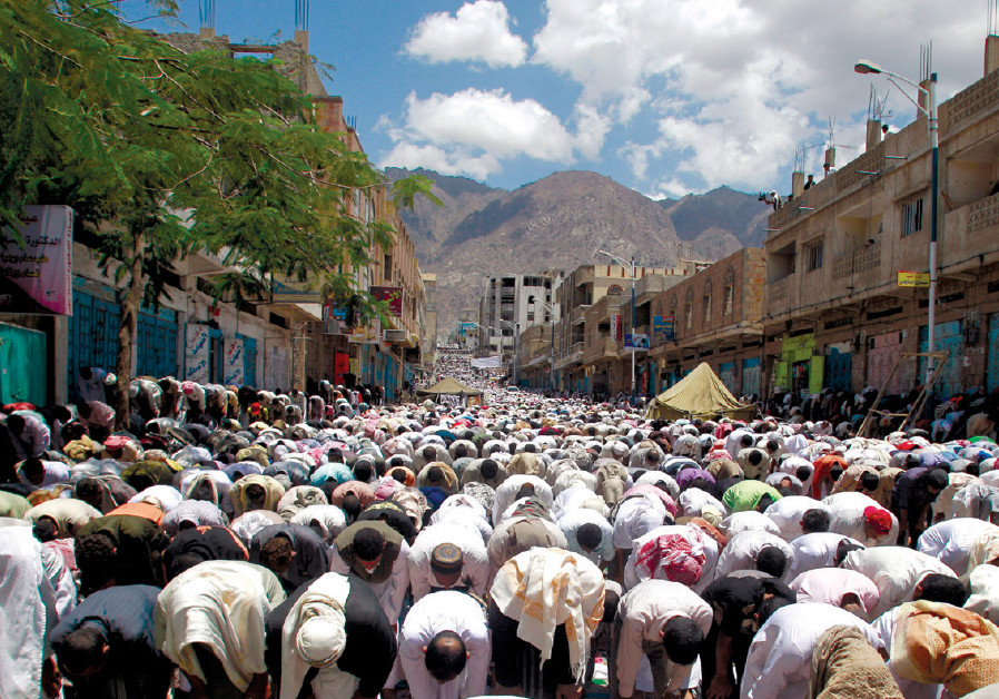 ANTI-GOVERNMENT protesters perform the Friday weekly prayers during a rally to demand the ouster of