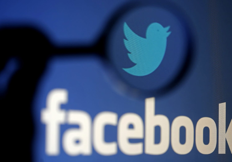 A LOGO of Twitter is pictured next to the logo of Facebook.