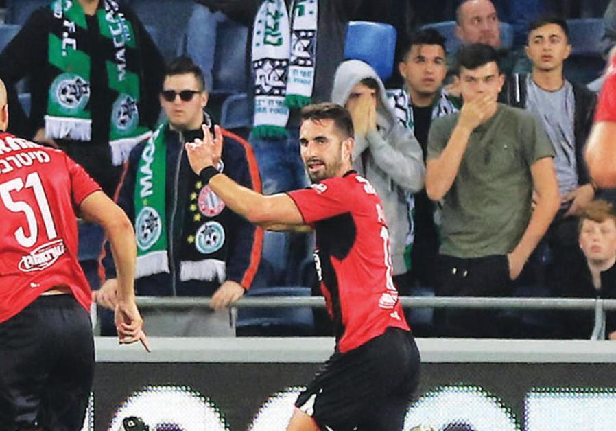 Hapoel Haifa striker Alon Turgeman celebrates after scoring his team's equalizer in last night's 1-1