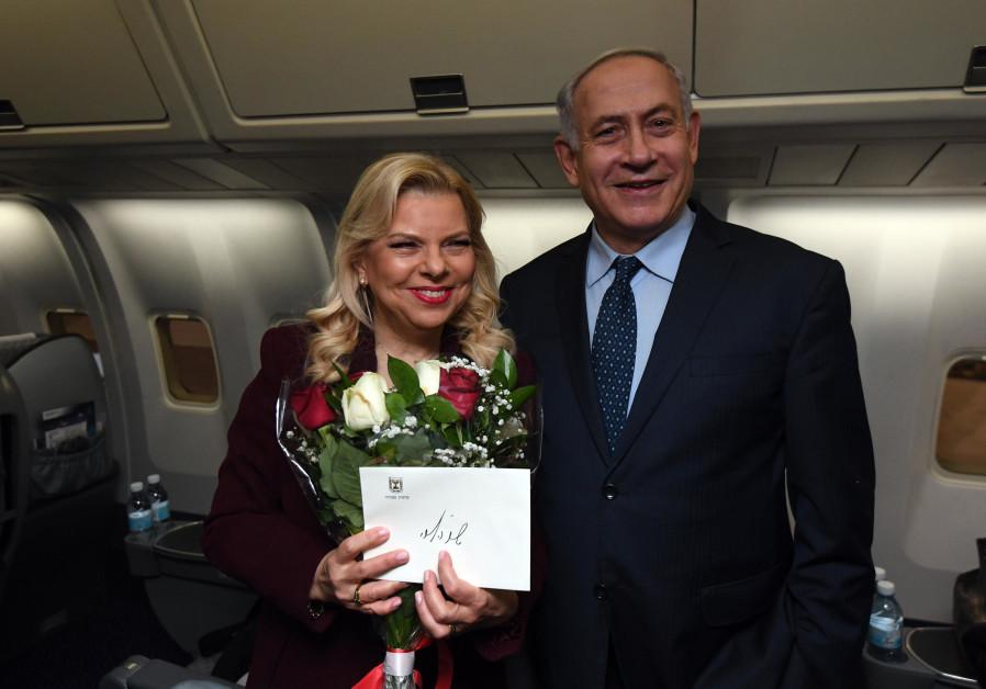 Under cloud of investigations, Netanyahu leaves for U.S.