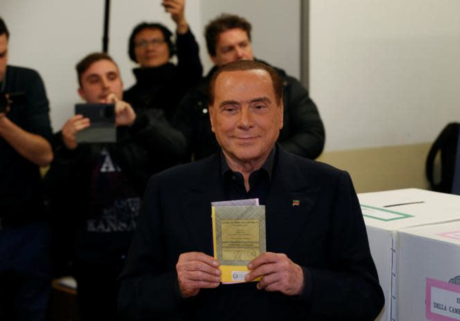 Forza Italia party leader Silvio Berlusconi casts his vote at a polling station in Milan, Italy.