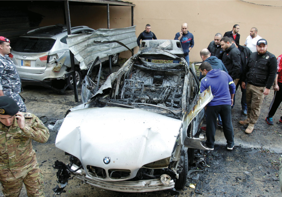 Security personnel inspect a damaged BMW in Sidon on January 14, after a reported assassination atte