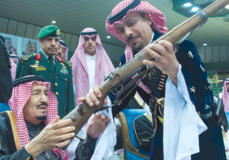 SAUDI ARABIA'S King Salman bin Abdulaziz Al Saud (left) attends a ceremony of the traditional Ardha