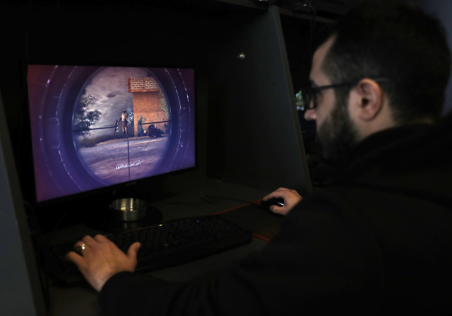 """A Lebanese man plays a computer game created by Hezbollah called """"Holy Defence"""""""