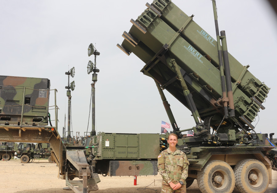 Second Lt. Jennifer Slade stands in front of an Air Defense Delta Battery