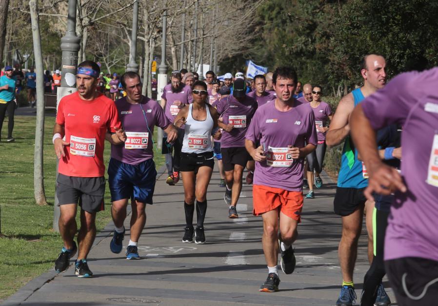 Runners participate in the Jerusalem marathon, March 2018