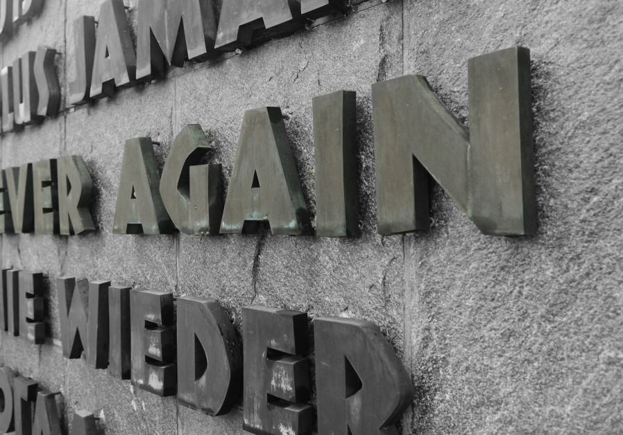 "A sign at Dachau Concentration Camp reading ""Never Again"""