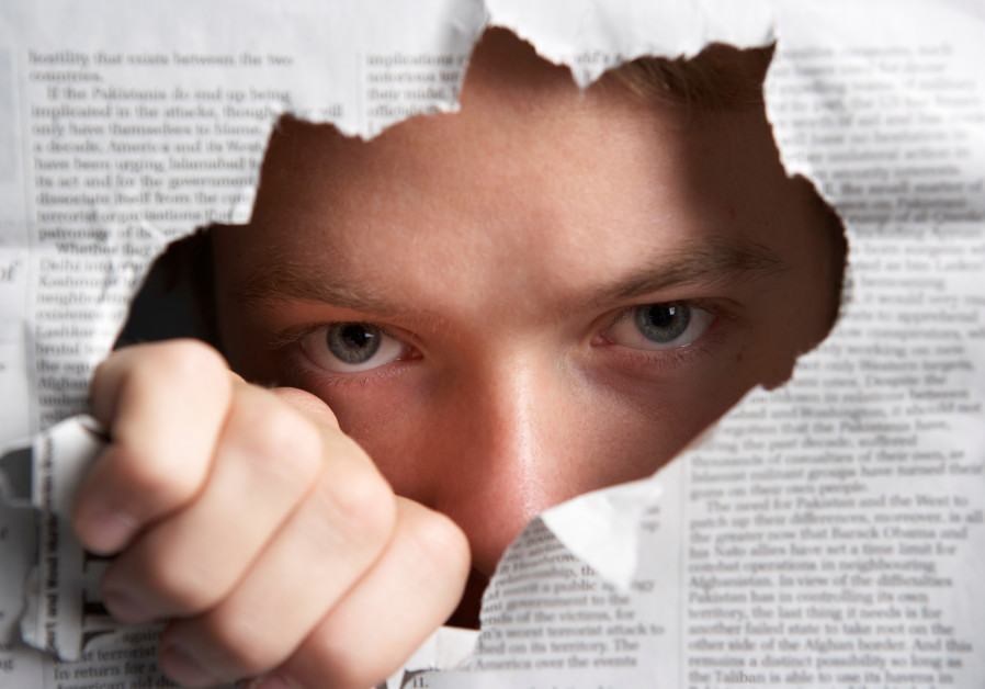 Man looking through hole in newspaper (Illustrative)