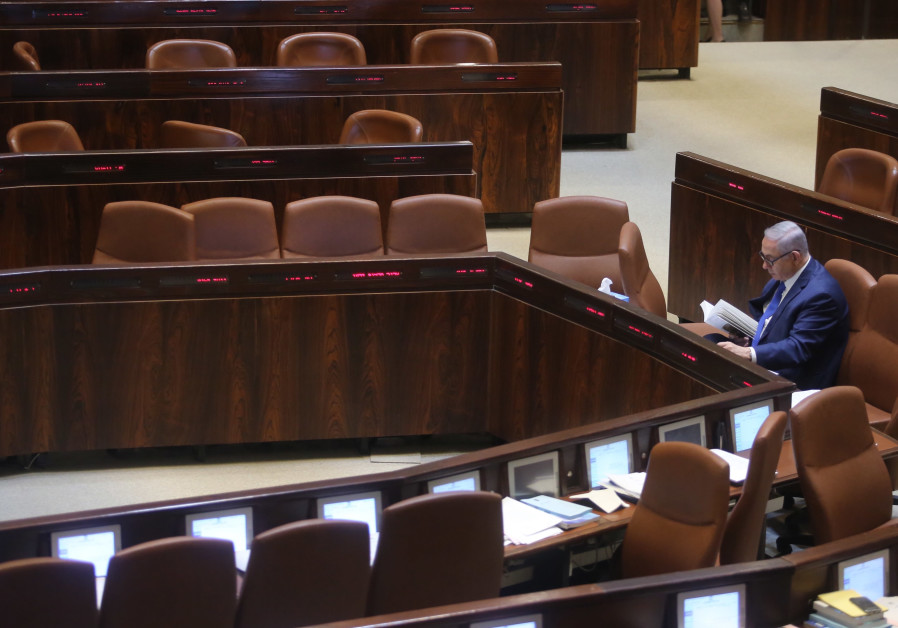 Prime Minister Benjamin Netanyahu sits alone at the Knesset before his speech on March 12, 2018