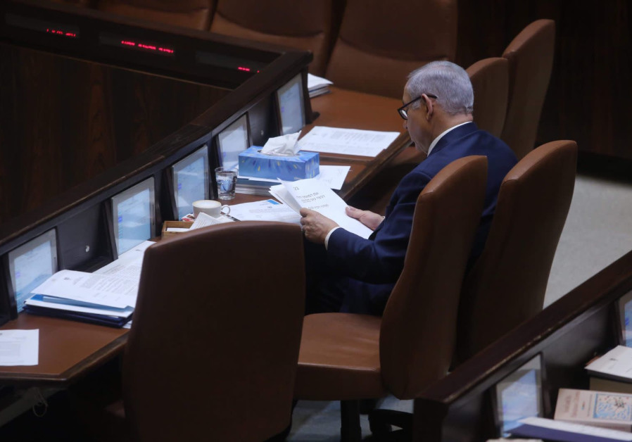 Prime Minister Benjamin Netanyahu reads from his speech in Knesset on March 12, 2018
