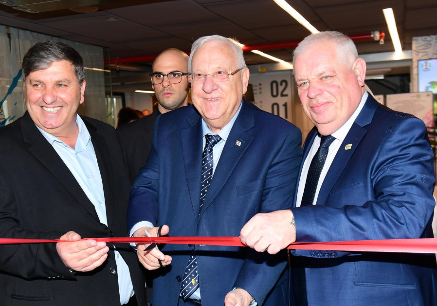 President Reuven Rivlin cuts the ribbon at the unveiling of a new JNF-KKL school in Upper Nazareth,