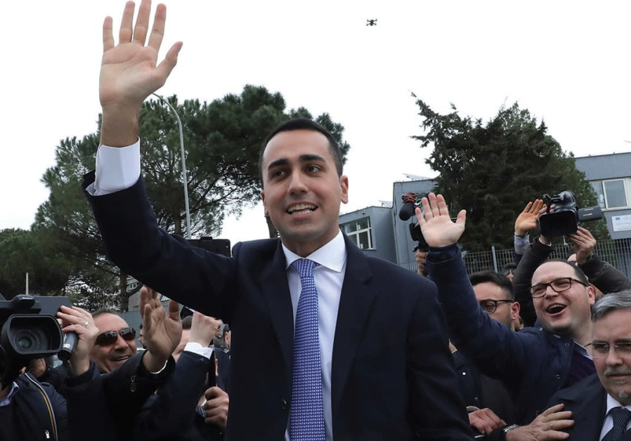 5-STAR MOVEMENT leader Luigi Di Maio waves as he leaves after casting his vote at a polling station.