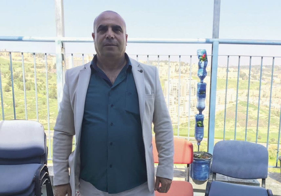 Amid threats, a pragmatic Arab Jerusalemite aims to get his community voting