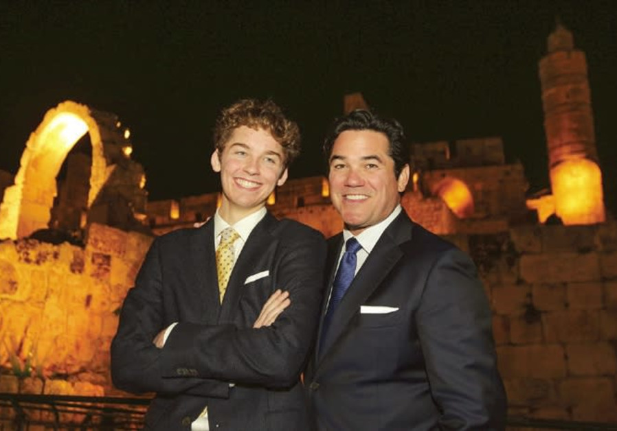 Actor Dean Cain, as incognito as Superman's alias Clark Kent, poses with his teenage son Christopher in front of the capital's Tower of David Museum last night. (Marc Israel Sellem/The Jerusalem Post)