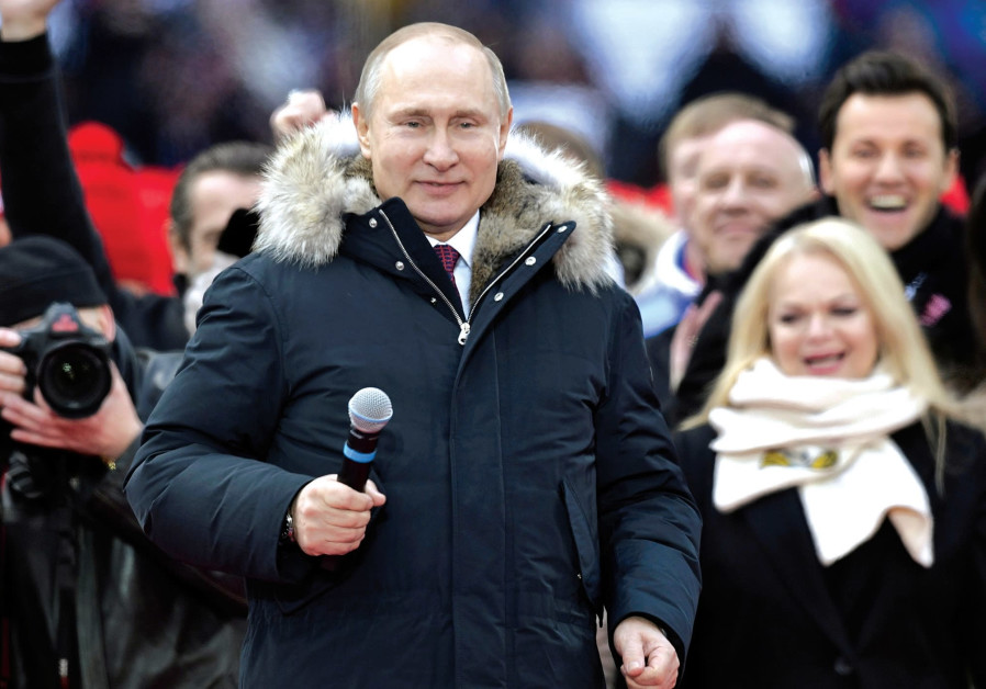 Vladimir Putin easily wins another six-year term, say exit polls