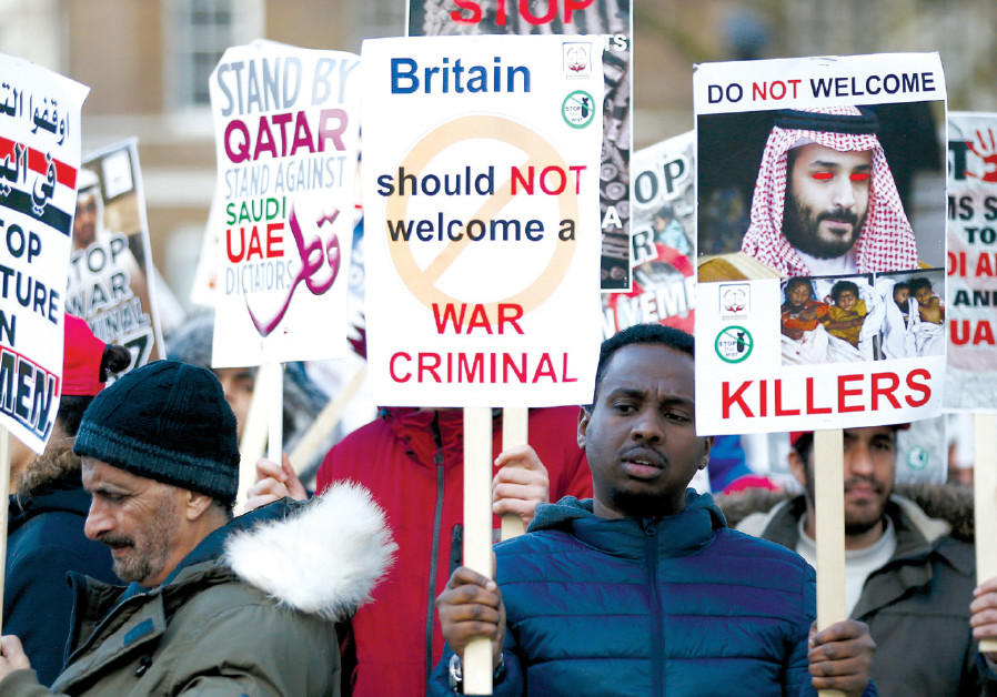 PROTESTERS WAVE placards opposite Downing Street before Saudi Crown Prince Mohammad bin Salman visit
