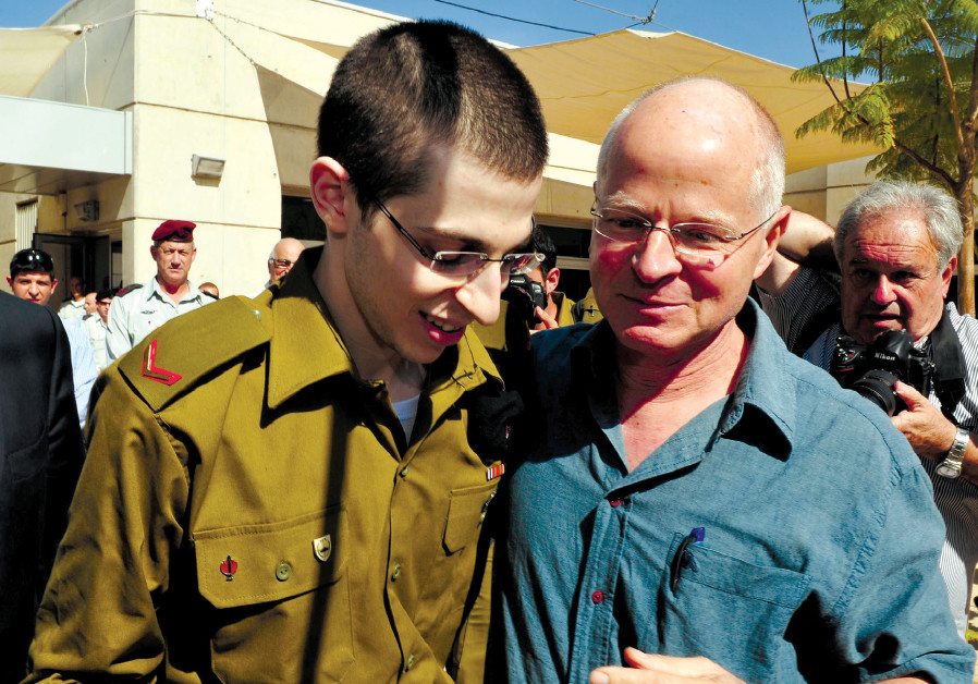 GILAD SCHALIT is reunited with his father, Noam, at the Tel Nof air base in 2011 after  ve years bei