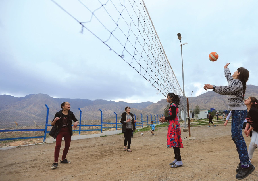 YAZIDI STUDENTS play last month near the psychotherapy center in the Rawanga camp in Iraq.