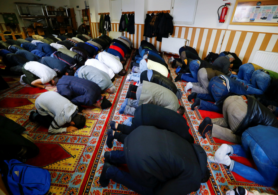 Muslims pray during Friday prayers at the Turkish Kuba Camii mosque.