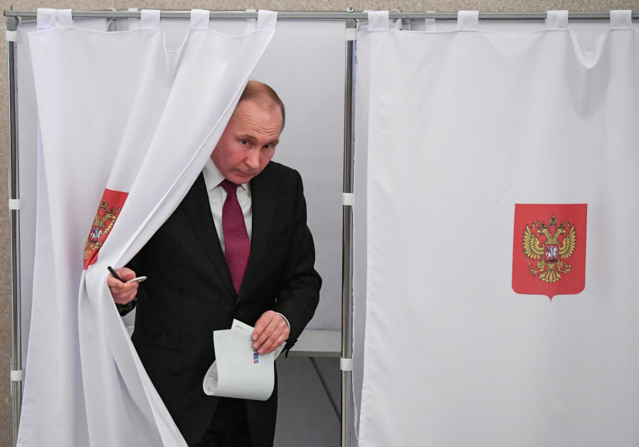 Vladimir Putin at a polling station during the presidential election in Russia