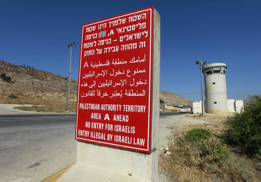 A sign stands at an Israeli checkpoint near the West Bank city of Nablus July 23, 2013