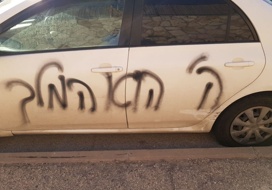 "A car vandalized with ""God is king"" in a suspected ""Price Tag"" attack in Pisgat Ze'ev, Jerusalem, on March 19, 2018."