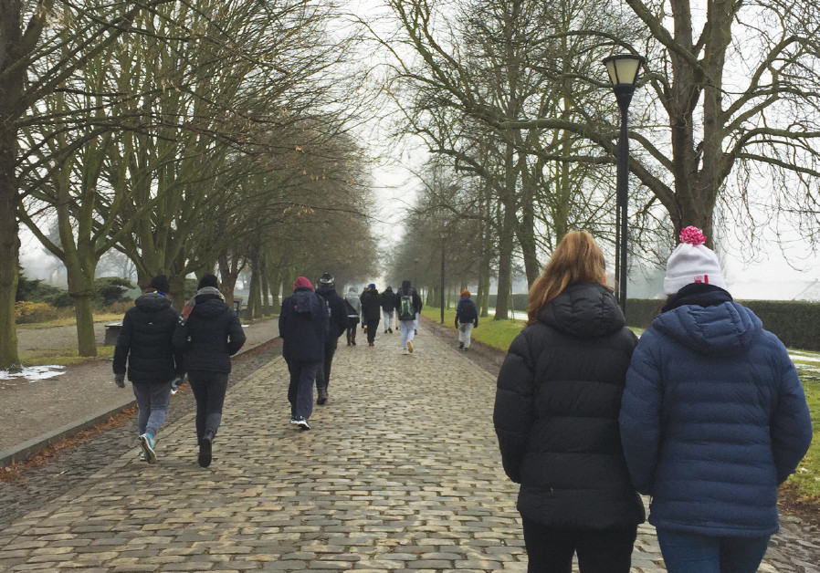 Students walking down the main road to the entrance of Theresienstadt
