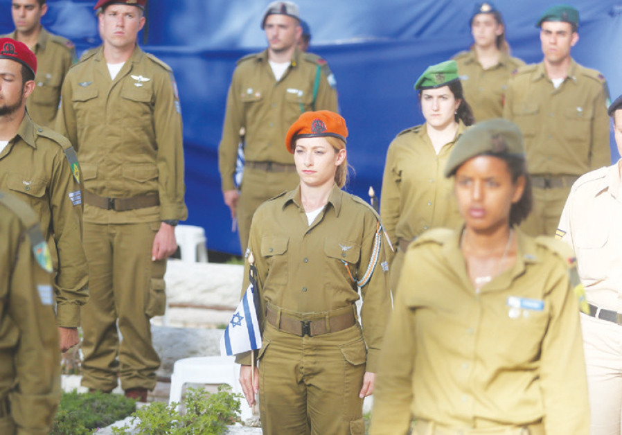 Male and female soldiers remember the fallen at a Remembrance Day ceremony on Jerusalem's Mount Herz
