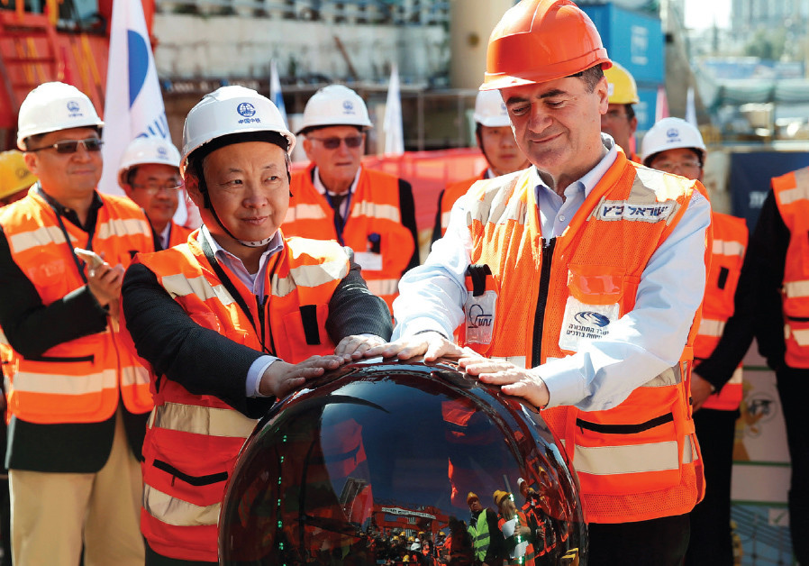 Transportation Minister Israel Katz and employees of China Railway Engineering Corporation join hand