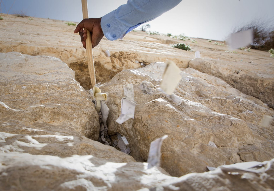 Notes are removed from the Western Wall as the site gets cleaned for Passover. (Credit: Hillel Meir/TPS)