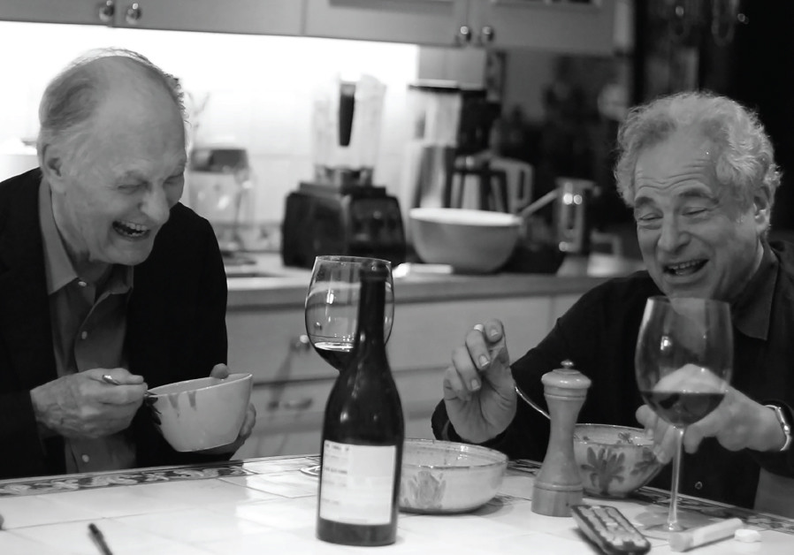 PERLMAN ENJOYS a good laugh with actor Alan Alda in a scene from 'Itzhak.'