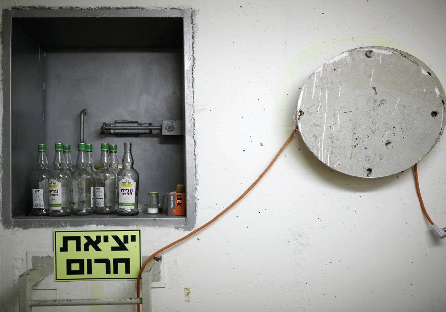 BOTTLES OF an alcoholic drink are seen in a bomb shelter in Ashkelon in 2014