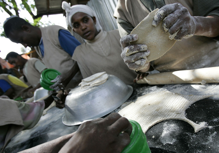 Jewish Ethiopians make matzah in preparation for Passover