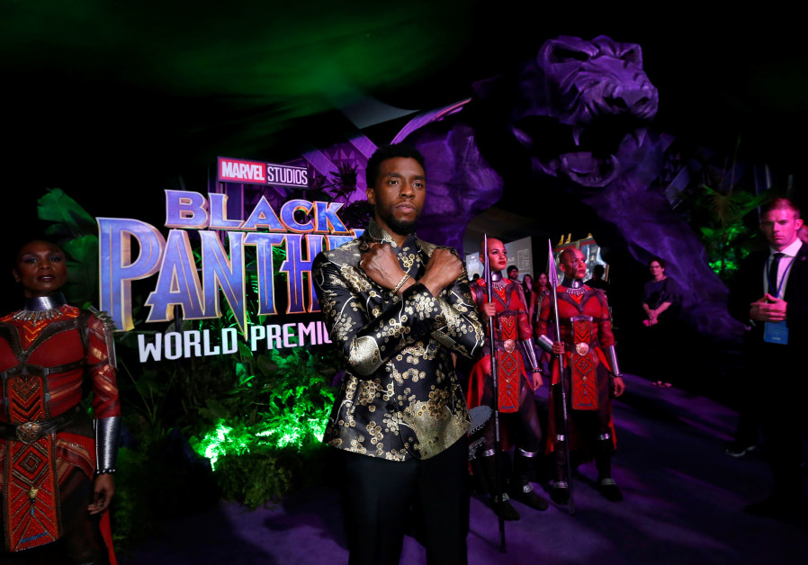 "Cast member Chadwick Boseman poses at the premiere of ""Black Panther"" in Los Angeles."