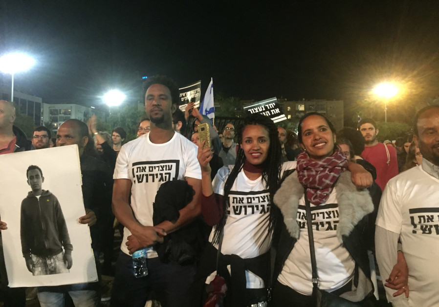 Participants in a protest in Tel Aviv against deportation of asylum seekers, March 2018