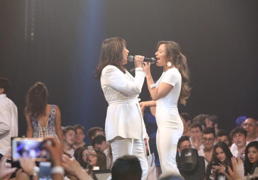 """Gali Atari (L) and Eden Ben-Zaken (R) duet the classic song """"Hallelujah""""."""