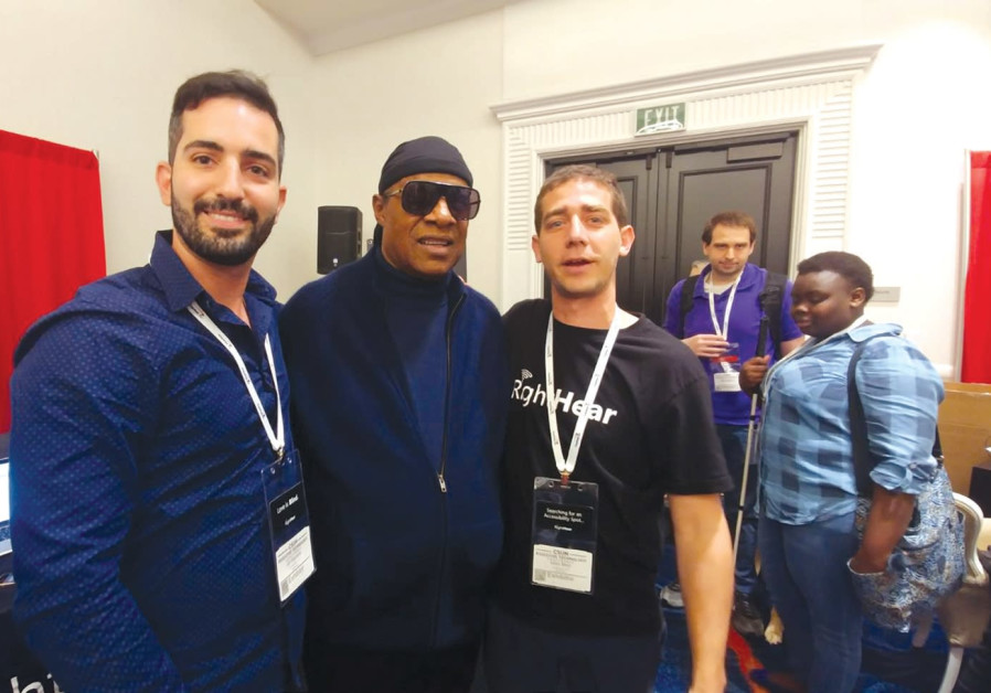 Stevie Wonder visits with Israeli start-up RightHear at a convention in California