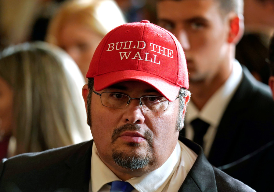 """Virginia Republican party leader Fredy Burgos wearing a """"Build the Wall"""" hat"""