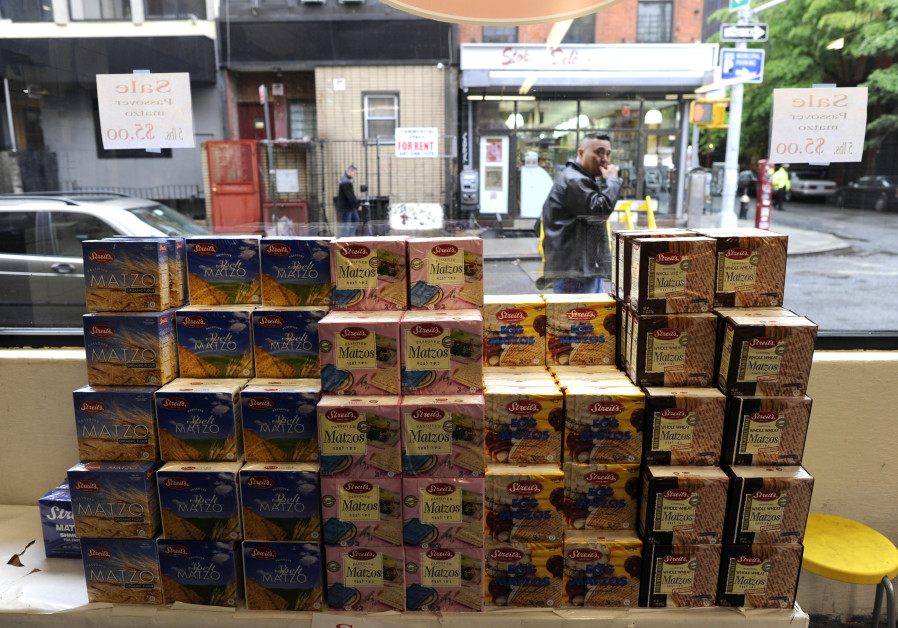 Packages of Passover Matzos sit in the window of a store on the lower east side of New York