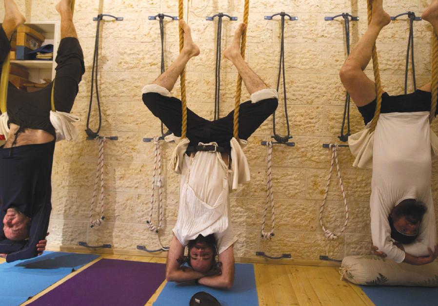 HAREDI MEN take part in a yoga class at a studio in Ramat Beit Shemesh in 2013