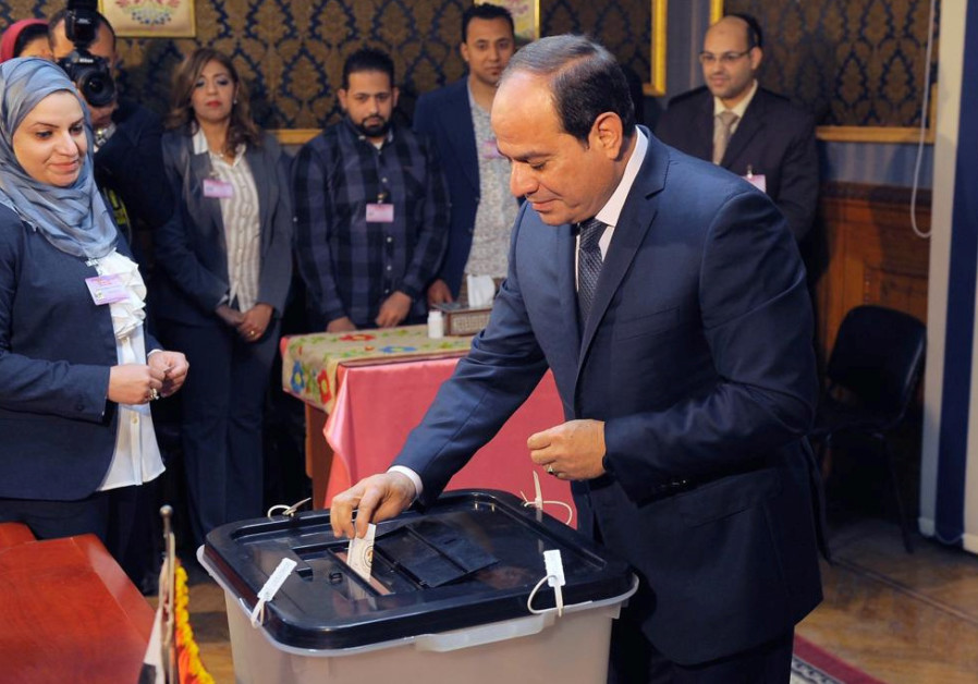 Egyptian President Abdel Fattah al-Sisi votes during the presidential election in Cairo, Egypt