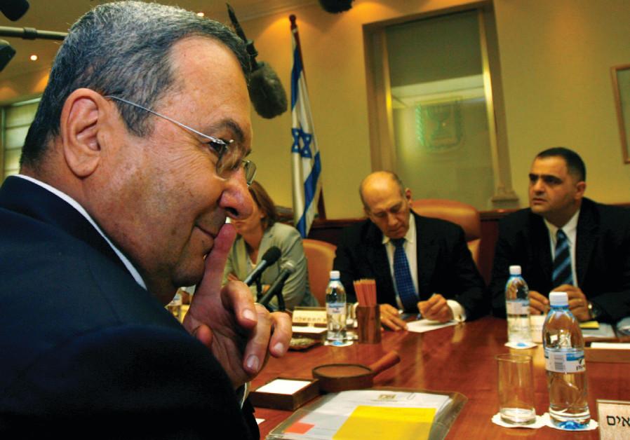 Then-defense minister Ehud Barak gestures as prime minister Ehud Olmert (center) convenes a cabinet